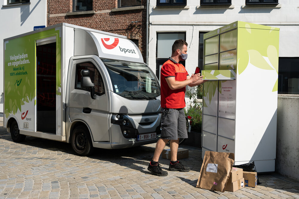 bpost delivery driver in eco friendly vehicle